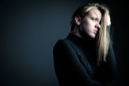 Young woman suffering from a severe stomach paindepressionanxiety (motion blur technique used to convey mood of unease) Stock Photo
