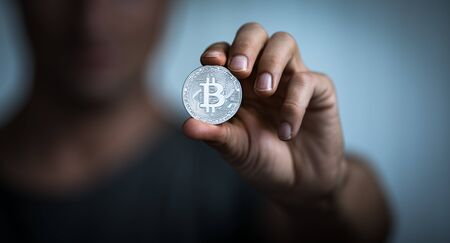 Bitcoin - Cryptocurrency concept - cryptocurrency being held as a value conserving asset as well a mean of swift exchange having a fungible, antiinflationary, decentralized nature
