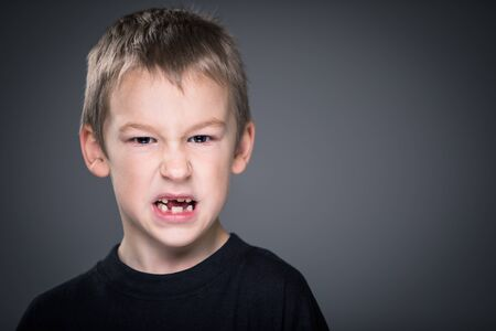 Loads of aggression in a little boy - education concept hinting behavioral problems in young children (shallow DOF)