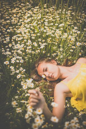 Portrait of young  woman with radiant clean outdoor on a springsummer sunny day Stock Photo