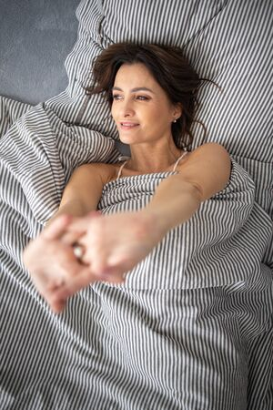Pretty, young woman in her bed, fast asleep. Importance of sleep concept Stok Fotoğraf - 137884487