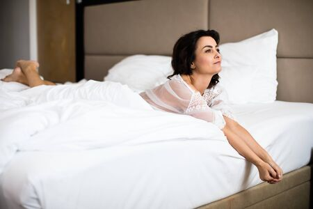 Pretty, young woman in her bed, fast asleep. Importance of sleep concept Stok Fotoğraf - 137884536