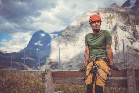 Young man climbing on a rock in Swiss Alps - via ferrataklettersteig 스톡 콘텐츠
