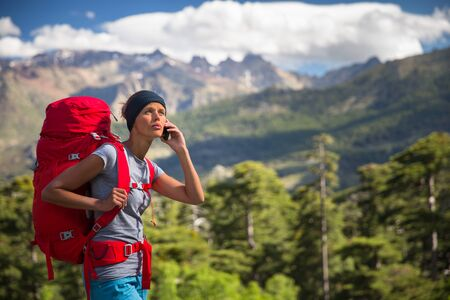 Pretty, female hiker in high mountains , calling for help - being injured and lost Standard-Bild