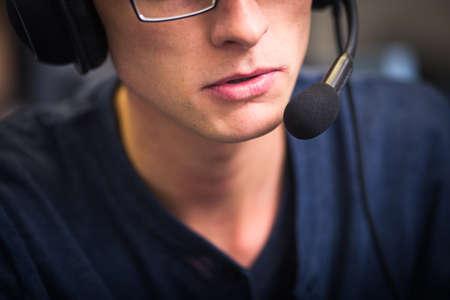 Interpreting - Male interpreter  simultaneous interpreter booth (shallow DOF) Banco de Imagens