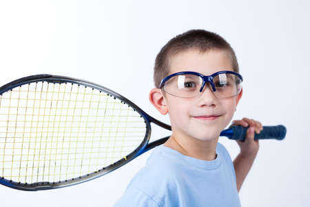 Young squash player with protective glasses and squash racket Imagens