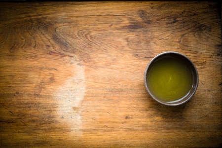 Green tea - gyokuro - served in a traditional tea bowl Stock fotó