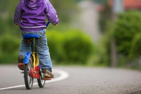 Little cyclist on a little bike (shallow DOF) Standard-Bild