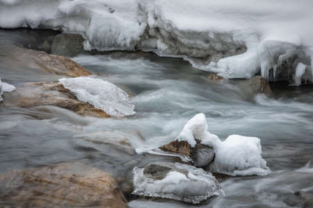Icy waters of a winter river - long exposure image