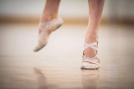 Legs and slippers of classical ballet dancers rehearsing Standard-Bild