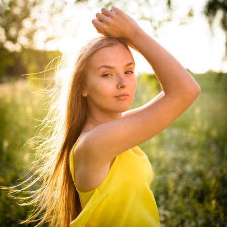 Portrait of young  woman with radiant clean outdoor on a spring/summer sunny day Standard-Bild