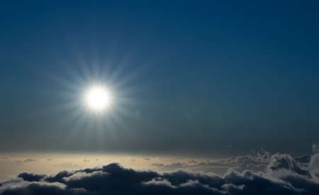 Sky above clouds with sun shining intensely - Earth's atmosphere concept Archivio Fotografico