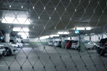 Underground parking. Cars parked in a garage with no people. Many cars in parking garage interior. Underground parking with cars (color toned image) Archivio Fotografico