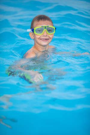 Cute little boy in a swimming pool Archivio Fotografico