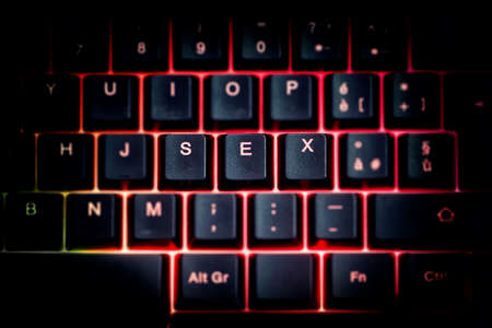 The word becomes one of the most popular on keyboards in the world. Quarantine blame or cheap sex? Banque d'images
