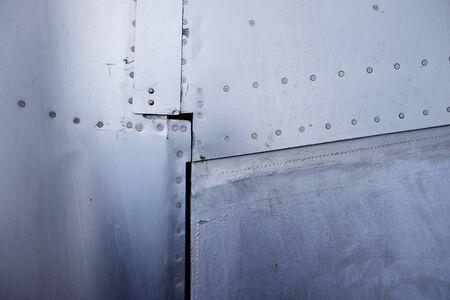 Close up of rivets aluminium. Aircraft fuselage and wing