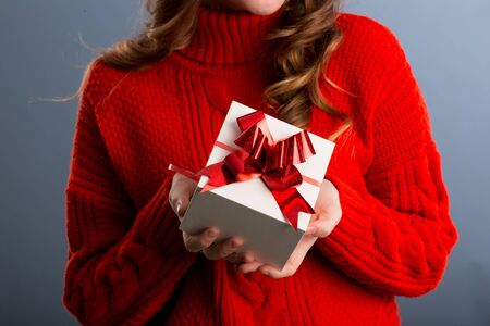 Close up view of hands are giving a beautiful gift box to you, female giving gift, presents and greeting season concept..