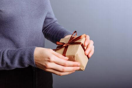 Very sexy and attractive lady opening christmas gift box. Girl celebrates holiday. Taking present from someone. surprise.. 写真素材