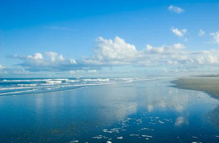 clouds reflecting in blue ocean surf photo