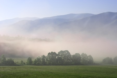 Early morning fog settling into the valley of Cades Cove in Great Smoky Mountain National Park, Tennessee, USA photo
