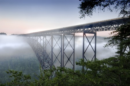 steel arch bridge: Beautiful view of the New River Gorge Bridge in West Virginia.  The largest Steel-Arch bridge in the Western Hemisphere