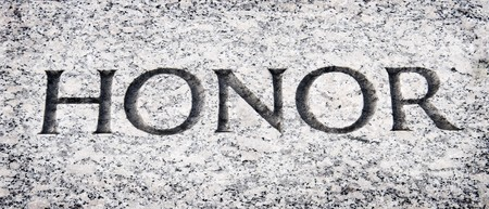 The word honor carved into stone