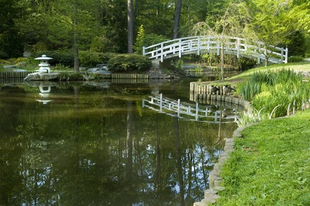Japanese Zen Garden with arched moon bridge and pagoda