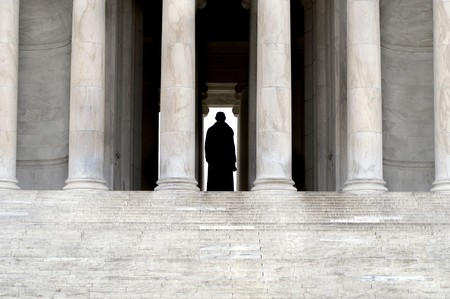 detail of the steps and columns of the Jefferson Memorial, showing silhouette of the statue of Thomas Jefferson photo