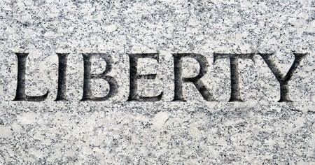 word: The word Liberty carved in stone