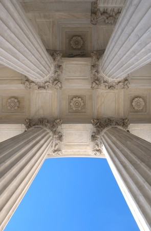 View looking up at the colums of the United States Supreme Court in Washington DC photo