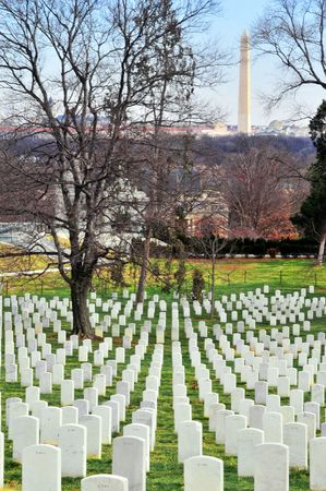 national military cemetery: Arlington cemetery at sunset with Wasington Monument in the background