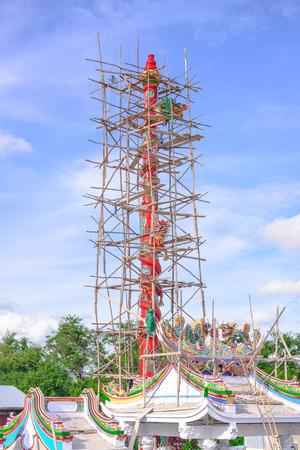 Building dragon pillars on Overcast sky photo