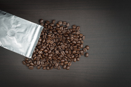 coffee beans: Top view coffee beans in aluminum foil bag package Stock Photo