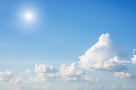 sun: Clouds and sun with blue sky background