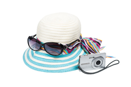 compact camera: Sunglasses, hat and compact camera isolate on white background