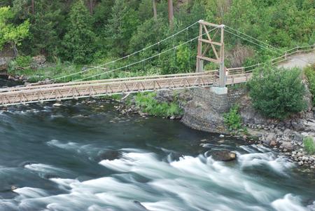 mountin: foot bridge over rapids