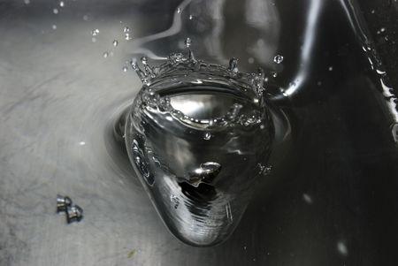 Bullet impacting water Stock Photo