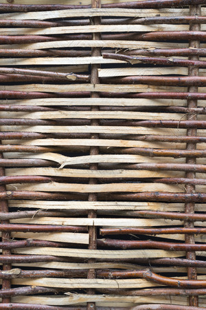 Section of a fence woven from willow twigs Stock Photo