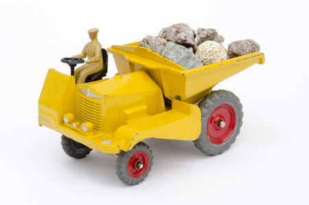 dinky: Toy tipper truck conceptualizing both work  play