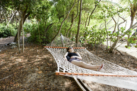 Young, teenage girl resting in a hammock in Key Largo, Florida