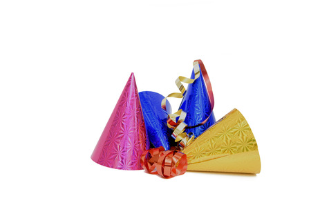 Party Hats. Pink, blue and gold metallic looking party hats with red and gold streamers isolated on a white background Stock Photo