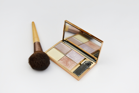 Makeup Brush and Palette with mirror, isolated on a white background Stock Photo