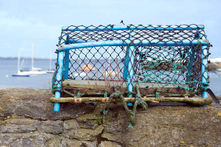 Lobster pot on a dock wall. Taken in Port St Mary in the Isle of Man