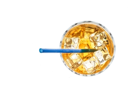 Cocktail on ice with blue drinking straw isolated on white. Stock Photo