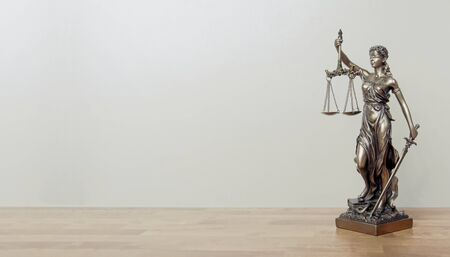 Lady Justice Statue on a table. Panoramic image with copy space. 版權商用圖片