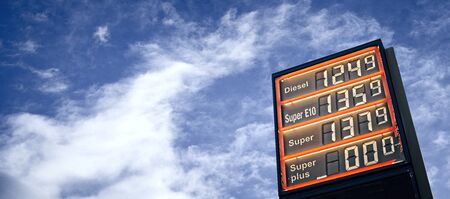 Gasoline price dispute benath a dramatic sky.