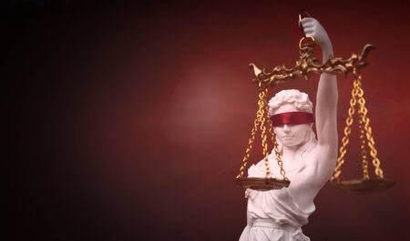Roman goddess of justice with red blindfold.