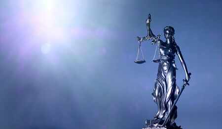 Lady justice or justitia - blindfolded figurine holding balance scale - Panoamic image wih copy space. 版權商用圖片
