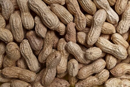 Roasted peanuts texture background. 版權商用圖片