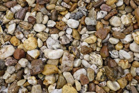 Wet pebble texture background.